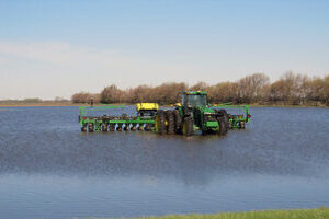 Farm machinary working on a flooded field